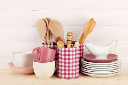 Cups, bowls nd other utensils in metal containers isolated on light background Stock Photo - 17291795