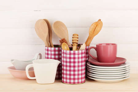 Cups, bowls nd other utensils in metal containers isolated on light background Stock Photo - 17291887