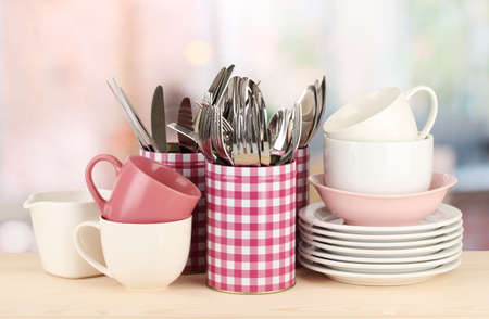 Cups, bowls nd other utensils in metal containers isolated on light background Stock Photo - 17291821