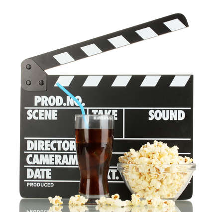 Movie clapperboard, cola y palomitas aislado en blanco photo