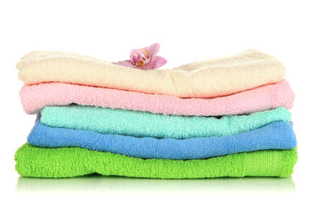 Stack of towels with fragrant flower isolated on white Stock Photo - 17292035