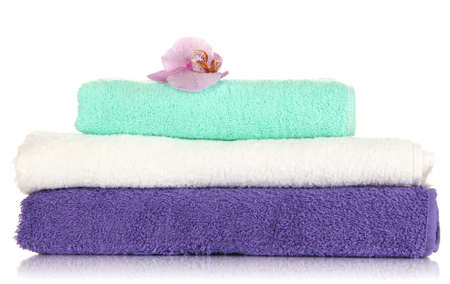 Stack of towels with fragrant flower isolated on white Stock Photo - 17291970