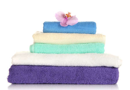 Stack of towels with fragrant flower isolated on white photo