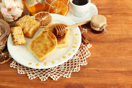 White bread toast with honey and cup of coffee on wooden table Stock Photo - 17292711