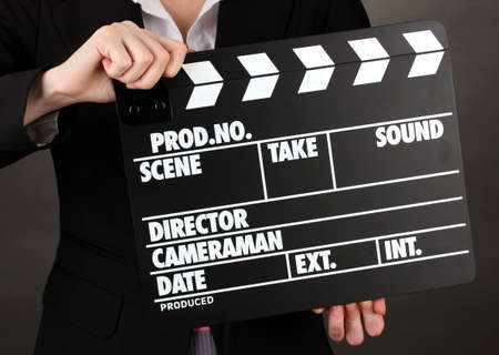 Movie production clapper board isolated on black photo