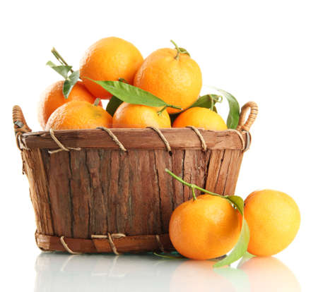 Ripe sweet tangerine with leaves in basket, isolated on white Stock Photo - 17291707