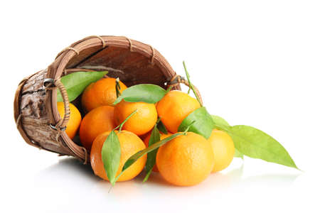 Ripe sweet tangerine with leaves in basket, isolated on white Stock Photo - 17291697