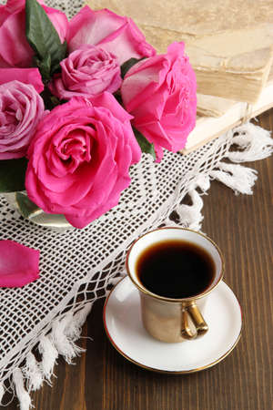 Beautiful pink roses in vase on wooden table close-up Stock Photo - 17292646
