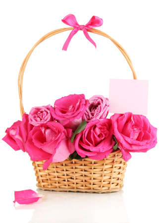 Beautiful pink roses in basket isolated on white photo