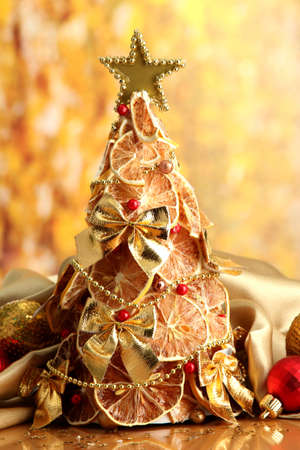 beautiful christmas tree of dry lemons with decor, on yellow background Stock Photo - 17292673