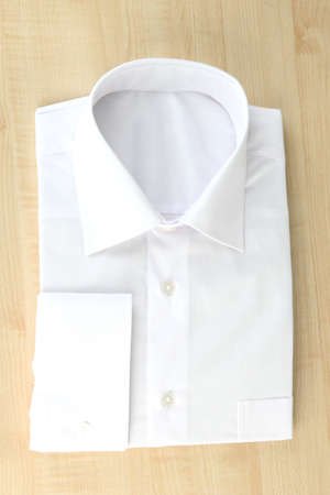 man's shirt: New white mans shirt on wooden background