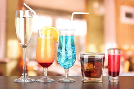 Several glasses of different drinks on bright background Stock Photo - 17292015