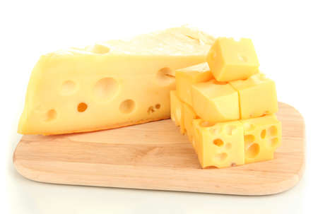 Cut cheese on wooden board isolated on white photo