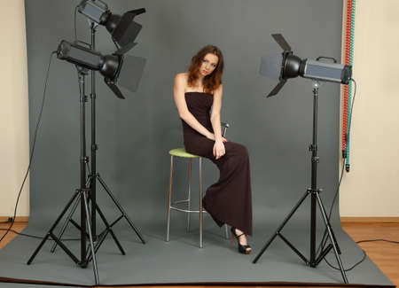 beautiful professional female model resting between shots in photography studio shoot set-up Stock Photo - 17544431