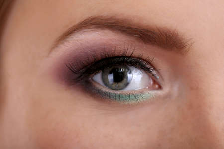 Beautiful female eye with bright  make-up, close up photo