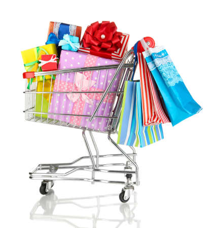 Christmas gifts and shopping in trolley isolated on white photo