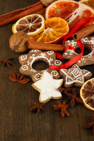 Dried citrus fruits, spices and cookies on wooden table close-up photo