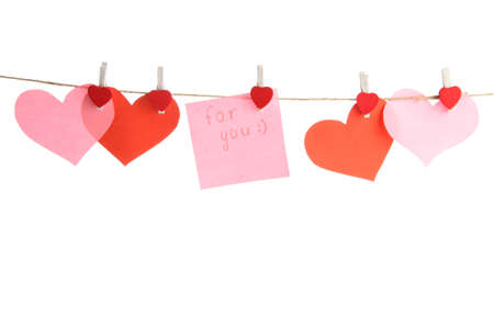 paper hearts and card on rope, isolated on white Stock Photo - 17289942