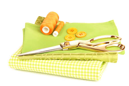 Sewing accessories and fabric isolated on white photo