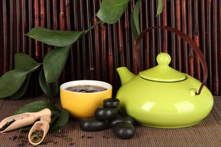 Chinese tea ceremony on bamboo table on bamboo background photo