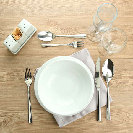 Table setting on wooden table photo