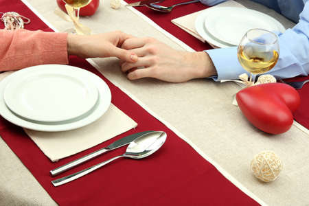 hands of romantic couple over a restaurant table Stock Photo - 17292678