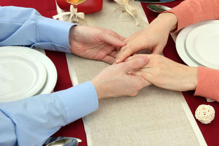 hands of romantic couple over a restaurant table Stock Photo - 17292719