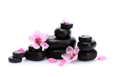 Spa stones with drops and pink sakura flowers isolated on white  Stock Photo - 17290040