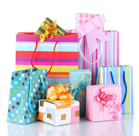 bright gift bags and gifts isolated on white Stock Photo - 17362476