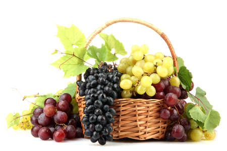 bunch of grapes: assortment of ripe sweet grapes in basket, isolated on white  Stock Photo