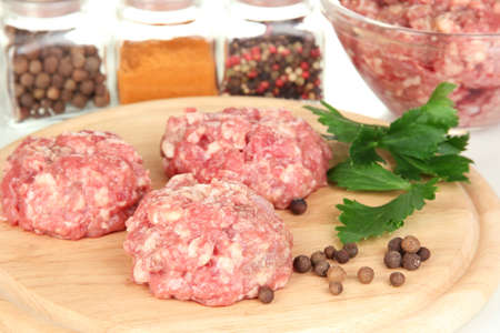 Raw meatballs with spices photo