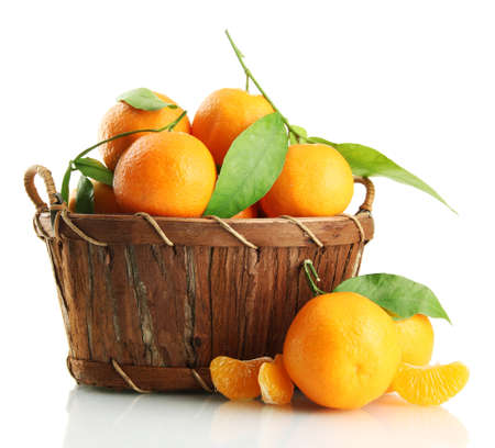 Ripe sweet tangerine with leaves in basket, isolated on white Stock Photo - 17348513