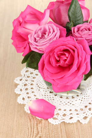 Beautiful pink roses in vase on wooden table close-up Stock Photo - 17348288