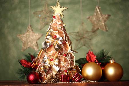 beautiful christmas tree of dry lemons with decor, on grey background Stock Photo - 17348234