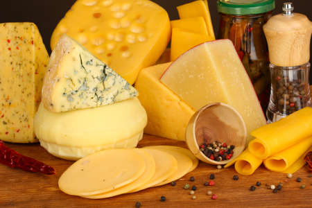 Various types of cheese on wooden table close up photo