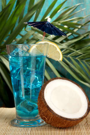 Blue Lagoon cocktail with coconut on tropical background Stock Photo - 17348237