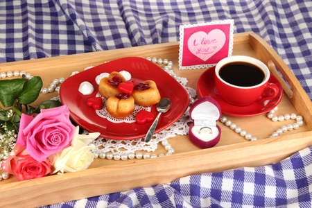 Breakfast in bed on Valentines Day close-up photo