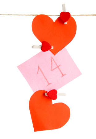 paper hearts and card on rope, isolated on white Stock Photo - 17348596