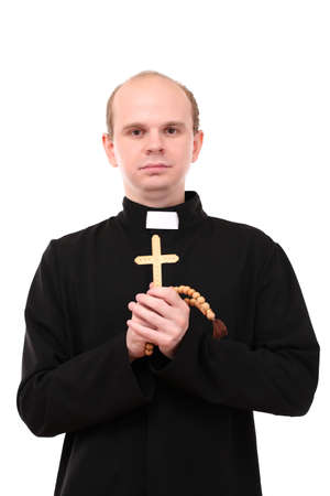 Young pastor with wooden cross and  rosary, isolated on  white photo