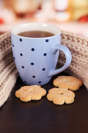 cup of tea with scarf on table in room Stock Photo - 17348408