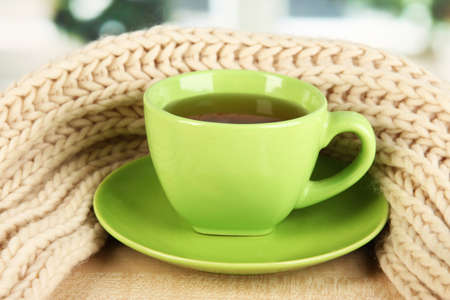 cup of tea with scarf on table in room Stock Photo - 17348267