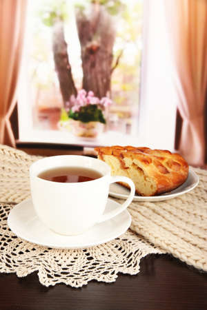 cup of tea with scarf on table in room Stock Photo - 17348415