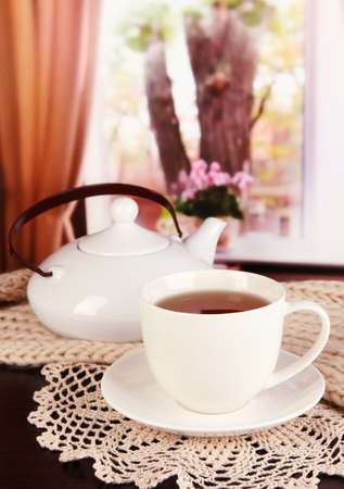 cup of tea with scarf on table in room Stock Photo - 17348478