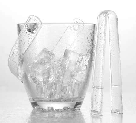 Glass ice bucket isolated on white photo