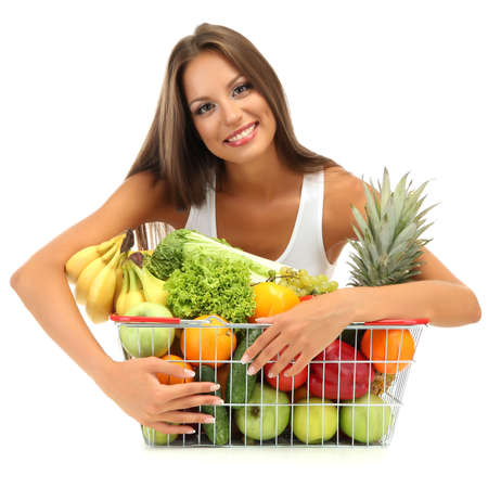 beautiful young woman with fruits and vegetables in shopping basket, isolated on white Stock Photo - 17544486