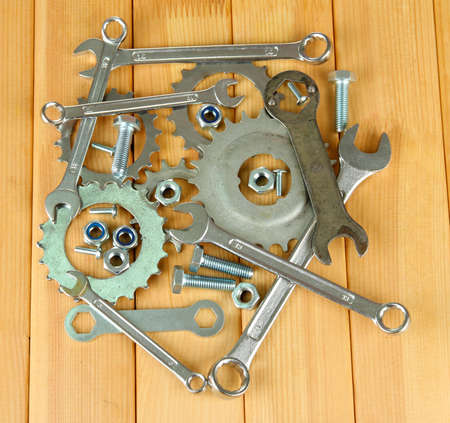 Machine gear, metal cogwheels, nuts and bolts on wooden background Stock Photo - 17399519
