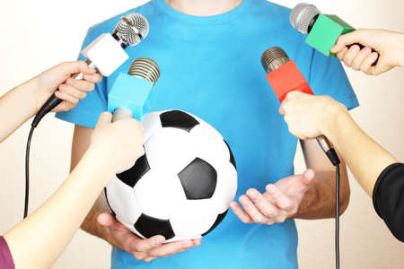Conference meeting microphones and footballer Stock Photo - 17399497
