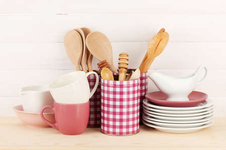 Cups, bowls nd other utensils in metal containers isolated on light background Stock Photo - 17399488