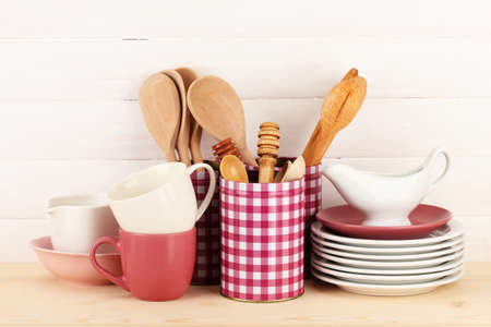 Cups, bowls nd other utensils in metal containers isolated on light background Stock Photo - 17399503