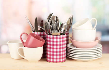 Cups, bowls nd other utensils in metal containers isolated on light background Stock Photo - 17399349